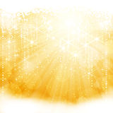 Abstract golden sparkling light burst with stars Stock Photography