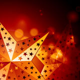 Abstract golden stars. Glowing golden star background and glows Royalty Free Stock Photos
