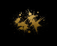 Abstract golden texture blots on the black background. Stock Image