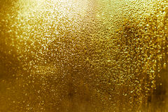Abstract golden texture, shimmer glowing defocused background. Water droplets and patterns Stock Photography