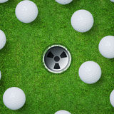 Abstract golf sport background of golf ball and golf hole on green grass background. Stock Image