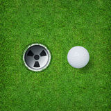 Abstract golf sport background of golf ball and golf hole on green grass background. Stock Photos