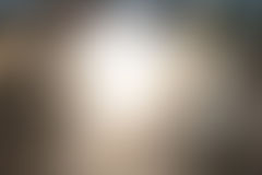 Abstract gradient blur gray background. Abstract blur gray background with white light in the middle Stock Images