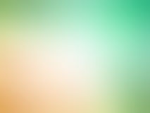 Abstract gradient orange green colored blurred background.  Stock Images