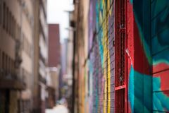 Abstract Graffiti decorated inner city allyway. An abstract view of an inner city allyway  in Johannesburg, brightly decorated with colourful graffiti, focussed Royalty Free Stock Photo