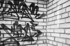 Abstract graffiti fragment on gray brick wal Royalty Free Stock Photos