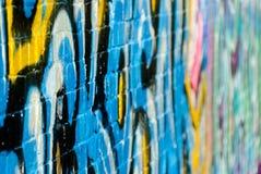 Abstract graffiti fragment on the textured brick w Stock Photos