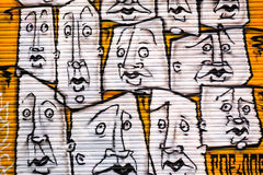 Abstract graffiti multiple faces, London UK Stock Images