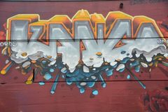 Abstract graffiti on red wall in Portland, Oregon royalty free stock photo