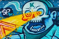 Abstract graffiti skull wall art. Abstract graffiti wall art, Skull shining laser eyes, Brick Lane, London Stock Photo