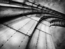 Abstract grand steel rainbow looking to the sky background. Futuristic urban design black and white stock images