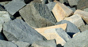 Abstract in granite. Huge blocks of granite being used as a breakwater but looking like a modern sculpture Stock Photo
