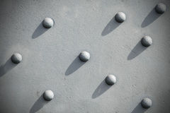 Abstract gray background, riveted metal textured. Stock Image