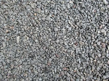 Abstract gray and beige crushed stone background - top view. Gravel poured in a uniform even layer Royalty Free Stock Photo