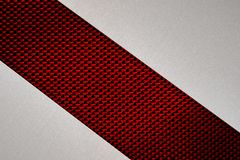 Abstract Gray Brushed Metal on Red Fibers Texture Background. Abstract geometric image of shiny cut grey brushed metal on red cloth fibers texture background for stock photo