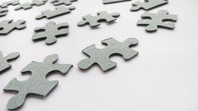 Abstract gray jigsaw puzzle pieces on white background stock photo