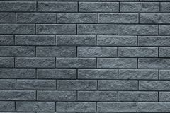 Abstract gray pattern of brick wall background. Light grey stone background. Grey bricks texture wallpaper backdrop of house facad. E. Gray decorative tiled wall royalty free stock photos