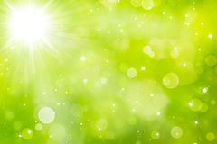 Abstract green background. Green background with sun and bokeh and sparkles Stock Photos