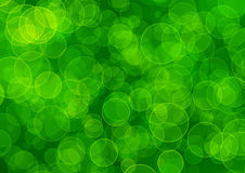 Abstract green background. Chaotically scattered translucent circles on darkly green background Royalty Free Stock Image