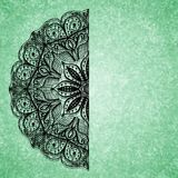 Abstract green background with black lacy mandala pattern Stock Images