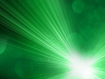Green Abstract Background. Abstract green background with bursts of light and energy rays Stock Images