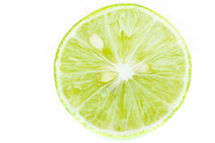 Abstract green background with citrus-fruit of lime slices. Clos Royalty Free Stock Images