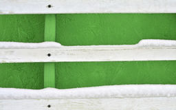 Abstract green background. Greenery wooden wall with three white scratched planks with nail on wood. On the planks a snow. Place for design and text Stock Photos