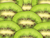 Abstract green background with raw kiwi slices Royalty Free Stock Image