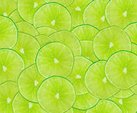 Abstract green background with slice of lime. Abstract green background with citrus-fruit of lime slices. Close-up. Studio photography Royalty Free Stock Photos