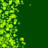 Abstract green background with yellow bokeh circles Stock Image