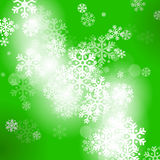 Abstract green christmas background. With snowflakes Royalty Free Stock Photography
