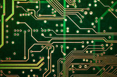 Abstract green circuit board PCB Closeup. Detail of green circuit board PCB Royalty Free Stock Photos