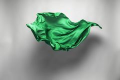 Abstract green fabric in motion royalty free stock image