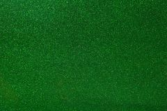 Abstract green glitter texture background. Glowing shiny paper for warp your gift box or party decoration. Texture stock photo