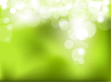 Abstract green glowing background Stock Images