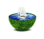 Abstract green planet with ocean and ship Royalty Free Stock Images