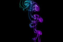 Abstract green and purple smoke from the aromatic sticks. Stock Photos