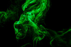 Abstract green smoke from the aromatic sticks. Stock Photos