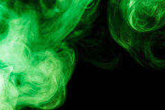 Abstract green smoke hookah on a black background. Royalty Free Stock Photo