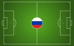 Abstract green soccer field. With white marks and russian national colors in center point Royalty Free Stock Image