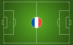 Abstract green soccer field. With white marks and france national colors in center point Stock Image