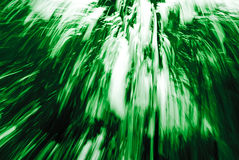 Abstract Green Streaks 91. An abstract image created by using a slow shutter speed while moving and/or adjusting the focal length of the lens.  Colors added and/ Royalty Free Stock Photos