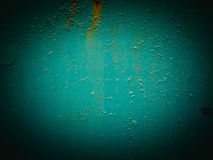 Abstract green texture with grunge cracks. Cracked paint on a metal surface. Bright urban background with rough paint transitions. Stock Photography