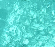 Blue texture of transparent ice, clear blue water Royalty Free Stock Photography