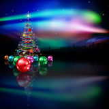 Abstract greeting with Christmas tree and stars. Abstract celebration dark background with Christmas tree and forest Stock Photos