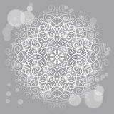 Abstract grey background with a round mandala ornament, sparkles. Mysterious abstract grey background with a round mandala ornament, sparkles and bokeh Stock Images