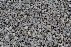 Abstract grey and beige gravel stone background, crushed gray stones and granite pieces texture, large detailed horizontal texture Royalty Free Stock Images