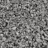 Abstract grey and beige gravel stone background, crushed gray stones and granite pieces texture, large detailed textured rough Stock Image