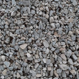 Abstract grey and beige gravel stone background, crushed gray stones and granite pieces texture, large detailed textured rough Stock Photo