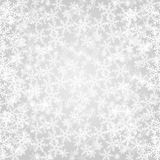 Abstract grey Christmas background with white snowflakes Stock Images